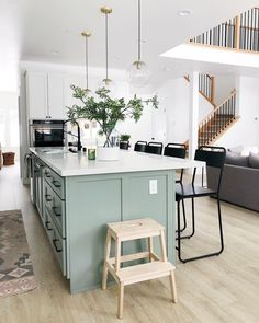 WINNER WINNER: white cabinets, pale green island, light wood floors, white countertops - or butcher block?✨ We don't know what we love more about kitchen, the pale green island or the perfectly placed outlet (perfect for standing… Kitchen Redo, Home Decor Kitchen, Interior Design Kitchen, Kitchen Living, New Kitchen, Home Kitchens, Kitchen Remodel, Glass Kitchen, Kitchen Ideas
