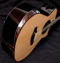 Everett Guitars - Hand Made Acoustic Guitars - Arm Bevels and Bridges