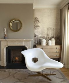 White Eames La Chaise lounge chair by Vitra from New Hampshire Antique Co-op.