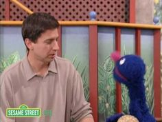Sesame Street: Frustrated Ray Romano And Grover