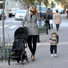 One hot mumma! Lara Bingle showed off her trim post-baby body in skin-tight trousers while out with older son Rocket in New York on Tuesday, just weeks after giving birth to her second son