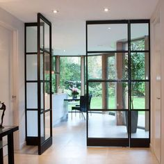 Single-glass steel doors, often with small diamonds and with putty. House Design, House, Steel Doors And Windows, Interior, Home, House Styles, House Interior, Internal Glass Doors, Interior Design