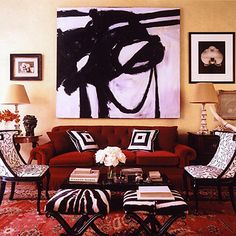 Red couch or accents with animal prints....can keep rug and use animal masks too....animal print throw pillows....wallpaper behind couch?