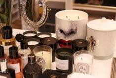 """Diptyque and Fornasetti candles. The Fornasetti here has a light smell of sandalwood. I like that it looks like a funky piece of art. It adds a little character to the room."""" #refinery29 http://www.refinery29.com/huda-kattan-makeup-products-advice#slide-7"""