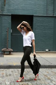 t-shirt, sleek pants, and a red pump