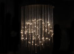 during milan design week 2012, german-born, london-based new media designer moritz waldemeyer presents his LED candles,  showcasing the soft lighting pieces in a threaded chandelier, as well as scattered throughout the space as candlesticks.