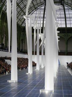 solar panels and wind turbines shape chanel runway at paris fashion week