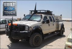 """gunrunnerhell:  Ford An armored triple cab Ford F550 used in Iraq by Private Military & Security Contractors. If you're wondering what those """"shark fins"""" on the bumper and top of the roof are for, they are meant to cut lines that are unintentionally or intentionally set low. This protects anyone standing in the turret or back of the truck bed."""