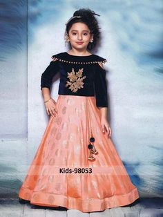 Adorable Peach And Navy Blue Color Paper Silk Hand Work Party Wear Lehenga Choli Gorgeously mesmerizing is what your little angel will look at the next wedding gala wearing this beautiful peach and navy blue color lehenga choli. Let her team this set with Kids Party Wear Dresses, Dresses Kids Girl, Girl Outfits, Eid Dresses, Kids Indian Wear, Kids Ethnic Wear, Kids Lehenga Choli, Silk Lehenga, Choli Dress