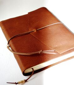 XL Rustic Leather Journal 9x6 Lined Paper LeatherRugged Gift for Writer Diary Jotter Rough Hewn Style. $60.00, via Etsy.