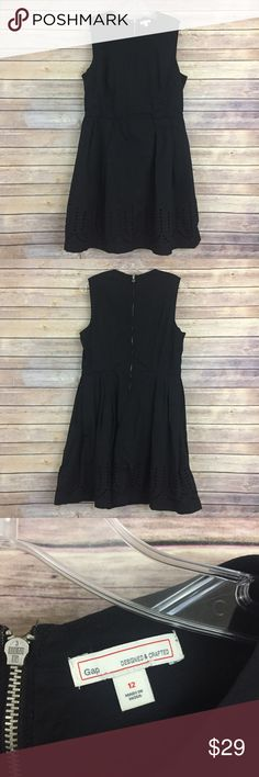 """Gap black cotton laser cut hem dress, 12 (#223) This super flattering black cotton dress is slightly a-line and has pretty laser cutout detail along the hemline! It is a size 12 and measures 18"""" flat across the bust and 16"""" flat across the waist and is 37"""" long. GAP Dresses"""
