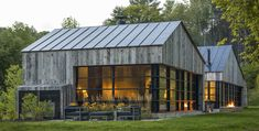 Sited in a clearing on a steeply sloping and heavily wooded site, Woodshed is both a guest house and entertainment space