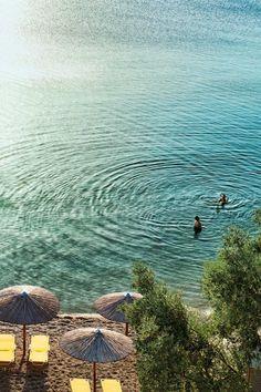"Sunbathers on Afissos beach. Read all about [link url=""http://www.cntraveller.com/gallery/pelion-greece""]Pelion[/link] here"