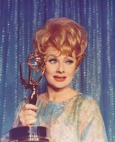 Lucille Ball accepts one of the five Emmy Awards she received during her career. She was nominated 14 times!