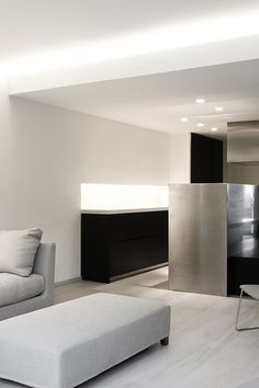 Interior of the ANB House by Spanish office Fusina 6|Enrica Mosciaro. Nice shades of white and grey.