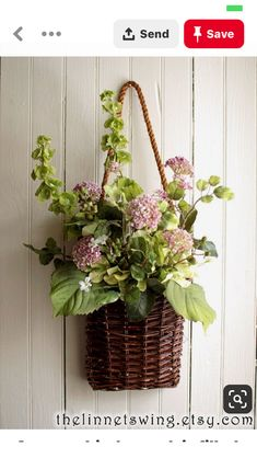 A woven birch pouch is filled with amazingly life-like lavender allium blooms. T… A woven birch pouch is filled with amazingly life-like lavender allium blooms. Two silk Bells of Ireland arch gracefully along the sisal handle. Front Door Decor, Wreaths For Front Door, Door Wreaths, Front Doors, Basket Flower Arrangements, Floral Arrangements, Deco Floral, Baskets On Wall, Flower Basket