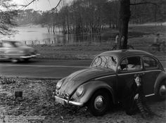 Lieper Bay (1956)  In the 1950s, automobiles (especially the new small cars like the Volkswagen Beetle or the BMW Isetta) became increasingly popular means of transportation for excursions and vacation travel. In the photograph below, Marion Günther, an acquaintance of the photographer Friedrich Seidenstücker, leans against the door of a VW Bug during an excursion in Grunewald
