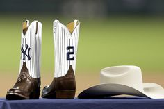 Texas Gift Giving, April The Houston Astros present Derek Jeter apair of custom boots and a Stetson hat New York Yankees Baseball, Ny Yankees, Striped Boots, Softball Shirts, Buster Posey, Custom Boots, American League, Derek Jeter, St Louis Cardinals