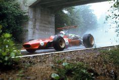 """Chris Amon in his Ferrari 242C under the bridge at """"Aremberg"""" 1968"""