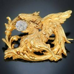 http://www.etsy.com/listing/79878293/antique-diamond-yellow-griffin-gold-pin Antique diamond yellow griffin gold pin