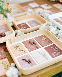 """Martha Stewart Weddings on Instagram: """"For this escort card display, this couple had names and table numbers calligraphed on mauve, rust, ivory, and peach cards. They were…"""""""