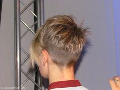Back view of a very short haircut for girls and women. Attractive buzzed nape area. A great cut to keep your neck cool in summer! Photo provided by http://www.hairfinder.com