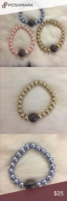 Handmade  pack of three bracelets Handmade pack of three bracelets. The package includes 1 Gold glass pearl bracelet with a gray bead The second bracelet is blue glass pearls with a gray bead. The last bracelet in the pack is pink with a gray bead Jewelry Bracelets