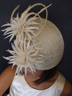 Wedding  hat with two feathers  flower  straw, via Etsy.