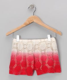 Dipped in color and covered in crochet, these elastic waistband shorts are a complementary combination of fun and fashion.