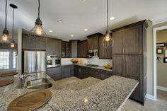 The Mulberry kitchen with dark cabinets and wire pendent lighting #wellborncabinets
