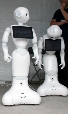 """Pepper is described as an """"emotional robot"""" because it will eventually be able """"read"""" human emotions by judging facial expressions and tone of voice."""