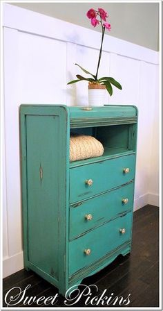 Did something similar with a free roadside dresser. I had the top 2 drawers removed & replaced the with one shelf. Painted the dresser tomato red, the drawer fronts turquoise blue, added turquoise blue acrylic knobs, painted the insides of the drawers green except the bottoms which got cute fabric covered panels. Love it!