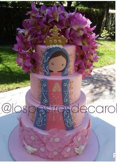 4 layer cake white with colorful Mexican patterns and bottom layer colorful flowers, virgencita same- no purple flowers top