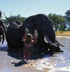 Young girl who's best friends with African wildlife