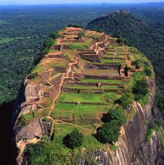 Sigiriya - Known as Lion's Rock.  It's a fortress and palace ruin in the Matale District of Sri Lanka.  It is surrounded by gardens has many ancient paintings.  Thought to have been built between 477 and 495 AD.  It was used as a Buddhist monastery until the 14th century.