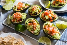 Smoky Southwestern Avocado Cups Recipe Appetizers, Main Dishes with cumin seed, avocado, avocado oil, onions, zucchini, sea salt, bell pepper, dried oregano, paprika, black beans, rice, chipotles in adobo, medium tomatoes, coarse salt, lime, cilantro, tortillas