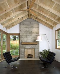 concrete fireplace and wood ceiling in Felton Gables residence by Arcanum Architecture