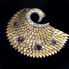 Art Deco 18k yellow gold spiral brooch with sapphire and diamonds stamped Creveli