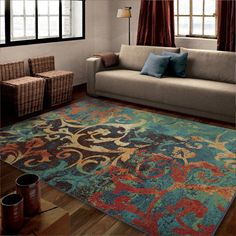 Watercolor Scroll offers a modern vibrant flair. This rug blends a contemporary watercolor style with a beautiful leaf design in rich colors that will bring style to any room and make your hardwoods really standout.