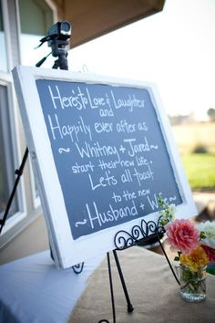 On one side of enterance of reception doors with pictures of the newlywed couple.