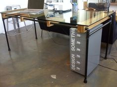 Glass Loft Dining Table by cushdesignstudio on Etsy, $700.00...   Love the use of graphics on the drawer unit!
