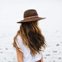 Brown hat.