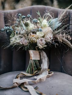 dried flower bouquet with pastel hues and subdued colors of blue, pale peach, light yellow and pink. Inspired by the dead fall flowers and Vermont's stick season. Perfect for a rustic fall or winter wedding with a vintage touch/