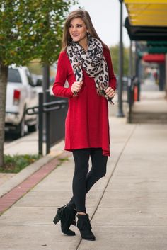 Red tunic with leggings, booties, and a leopard print scarf.