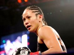 Former female world boxing champion Ana Julaton have been strutting her wares in MMA recently, but it doesn't mean she's hanging up her boxing gloves.  Julaton, 34, will compete in her third mixed martial arts contest this year in ONE FC on December 5 against Walaa Abas of Egypt.