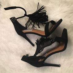 """STEVE MADDEN Black Fringe Heels BNWB - worn for a photo shoot only. Black Fringe Sandal. Sweeping fringe flounces on a lush suede sandal that's in step with this season's bohemian trend. A tubular ankle strap and slender heel complete the festival-ready look. 4"""" heel - 4 1/2"""" ankle strap height. Adjustable strap with buckle closure. Leather upper/synthetic lining/rubber sole. Steve Madden Shoes Heels"""