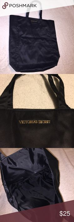 """VS Black Silk Tote NWOT perfect condition, took the tags off but never ended up using it! silver medal """"Victoria Secret"""" decal on front. silk like material. large pocket on front.  no pockets on inside. the last picture is the bag in relation to a 13"""" macbook air so you can get an idea of the size. Bags Totes"""