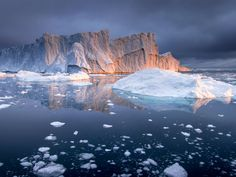 Jakobshavn Melt- was captured within the Kanjia Fjord, Greenland while on expedition to visually document of one of the largest calving events of 2016.  The objective of the journey was to promote environmental awareness and education of the significant climactic changes occurring in the Arctic. This single calving event produced enough ice to meet the domestic fresh water needs of the United States for six months. The image was captured at 1:00 am during the last sunset before summer's…