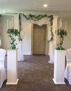 Aisle pillars, classic styling and entrance archway #piecesandposies