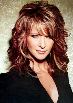 long shag curly haircut..,not my color but love cut